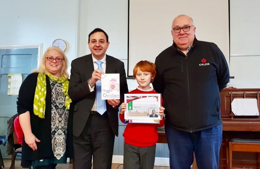 Alberto with Mrs Jo Blackburn, Head Teacher of Dunton Bassett Primary School, Last year's Christmas Card Competition Winner, Reggie Welham, and Mr Ally Statham, Distribution Manager of Calor Gas Stoney Stanton